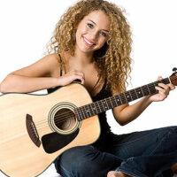 Mit Hilfe von Online Portalen Gitarre spielen lernen